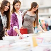 Three beautiful women buying books.   [url=http://www.istockphoto.com/search/lightbox/9786738][img]http://dl.dropbox.com/u/40117171/group.jpg[/img][/url]